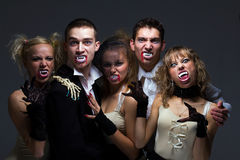 Hungry vampire family. Portrait of hungry vampire family on a gray background Stock Image