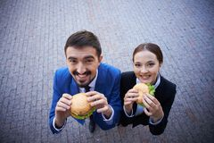Hungry white collar workers Stock Photos