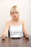 Hungry woman. Royalty Free Stock Images