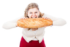Hungry woman with bread Royalty Free Stock Images