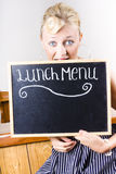 Hungry woman eating a cafe lunch menu Royalty Free Stock Image
