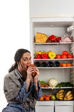 Hungry woman eats meat Royalty Free Stock Photography