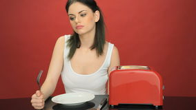 Hungry woman with an empty dinner plate stock video