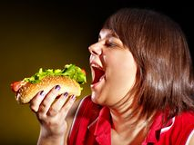 Hungry woman holding hamburger. Royalty Free Stock Images