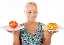 Hungry woman looking at food. Portrait of happy sexy woman making choice between food Stock Image