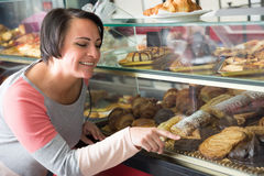 Free Hungry Woman Looking Into The Pastry Royalty Free Stock Photo - 73737025