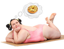 Hungry woman. Hungry overweight woman dreaming. Weight loss concept stock images