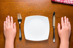Hungry woman waiting for dinner Stock Photos