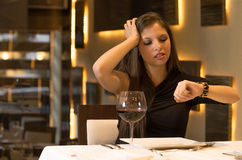 Hungry woman is waiting in a restaurant Royalty Free Stock Photo