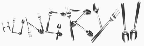 Hungry written with cutlery. The word hungry written with silver cutlery Royalty Free Stock Image