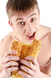 Hungry Young Man eating bread Royalty Free Stock Photos