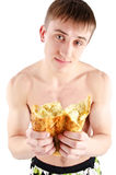 Hungry Young Man eating bread Royalty Free Stock Image
