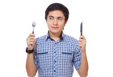 Hungry young man. With a knife and a fork Stock Photo