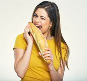 Hungry young woman  bites, eating bread. Royalty Free Stock Image
