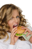 Hungry young woman with burger of dollars Royalty Free Stock Image