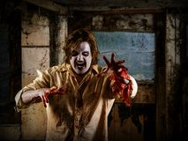 Hungry zombie coming to eat your brain. Photo of a hungry zombie about to attack you. Slight noise visible Stock Photos
