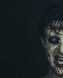 Hungry zombie. Half portrait of hungry zombie man with copy-space at left image, Halloween makeup Stock Photography