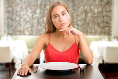 Hungy Woman Waiting With An Empty Plate Stock Images