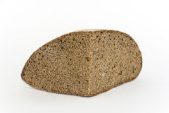 Hunk of black bread. Hunk fresh brown bread on a white background Stock Image