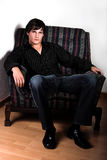 Hunk On Chair Royalty Free Stock Photo