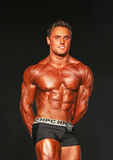 Hunky Bodybuilder Hits Ripped Pose Royalty Free Stock Photo