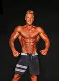 Hunky Male Bodybuilder Strikes a Pose Stock Photos