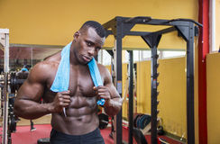Hunky muscular black bodybuilder resting after Stock Photos