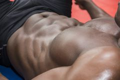 Hunky muscular black bodybuilder working out in Royalty Free Stock Image