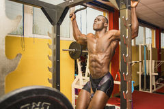 Hunky muscular black bodybuilder working out in Stock Images