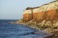 Sea and cliffs. Limestone and sandstone cliffs at Hunstanton Norfolk Royalty Free Stock Photography