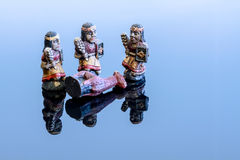Hunt for lame. Chess figurines placed on a blue background Royalty Free Stock Photo