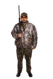 Hunter. In camouflage holding a rifle with his right hand, front facing, isolated on white Stock Photos