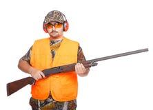 Hunter. Wearing a orange jacket while holding a shotgun, isolated on white Stock Images