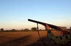 Hunter. With shotgun (morning sun-up Stock Photo