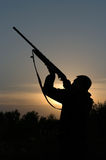 Hunter. Silhouette of the hunter with a gun against the evening sky Royalty Free Stock Photography