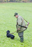 Hunter. With his dog hunting Stock Images