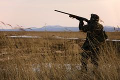 Hunter. With rifle at spring hunting season Stock Images