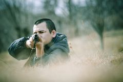 Hunter. A hunter takes aim at a traget with his shotgun Stock Images