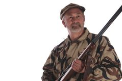 Hunter. In green camouflage holding a rifle Royalty Free Stock Photo