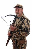 Hunter. Holding a crossbow on white Royalty Free Stock Images