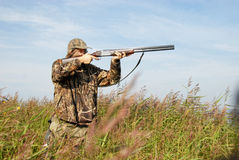 Hunter. Duck hunter aiming his shotgun Royalty Free Stock Photo