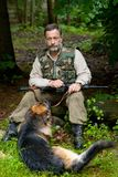 Hunter. With a dog that listens to the noise in the woods Stock Images