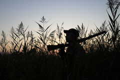 The hunter. Silhouette of the hunter on a background of a morning dawn Stock Photo