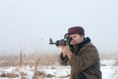 The hunter. Aims from the hunting carbine Stock Photos