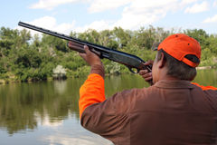 The Hunter. Duck Hunter Out Hunting ducks dressed in safety hunting gear stock photos
