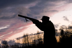 The hunter. Silhouette of the hunter on a background of a morning dawn Stock Images