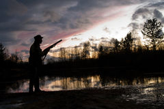 The hunter. Silhouette of the hunter on a background of a morning dawn Royalty Free Stock Images