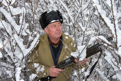 The hunter. In the winter on a marge of a wood Stock Photos