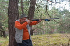 Free Hunter Aim Rifle In Pine Forest Stock Photos - 76055643