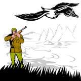 Hunter aiming at duck Stock Image